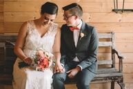 Lilly Leyh (26 and works in education) and Sadie Pierce's (28and a social worker) rustic barn reception was decorated with worn wood details and an or