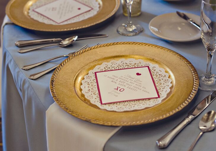 Lace doilies and personalized thank-you cards sat atop gold chargers on the guest tables.