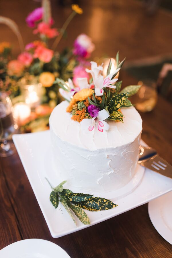 Coconut Buttercream Cake with Colorful Flowers