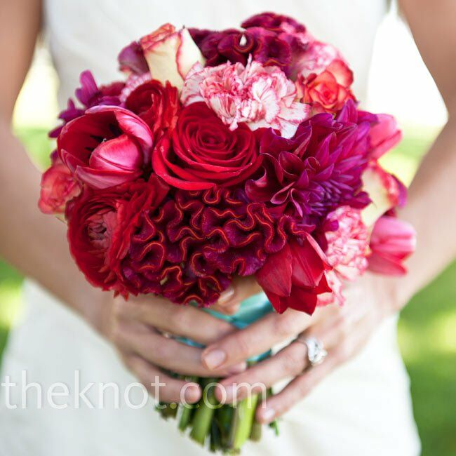 The bride carried a similar, but larger bouquet of coxcomb, roses, tulips and dahlias, with some cream and red-tipped roses tucked in.