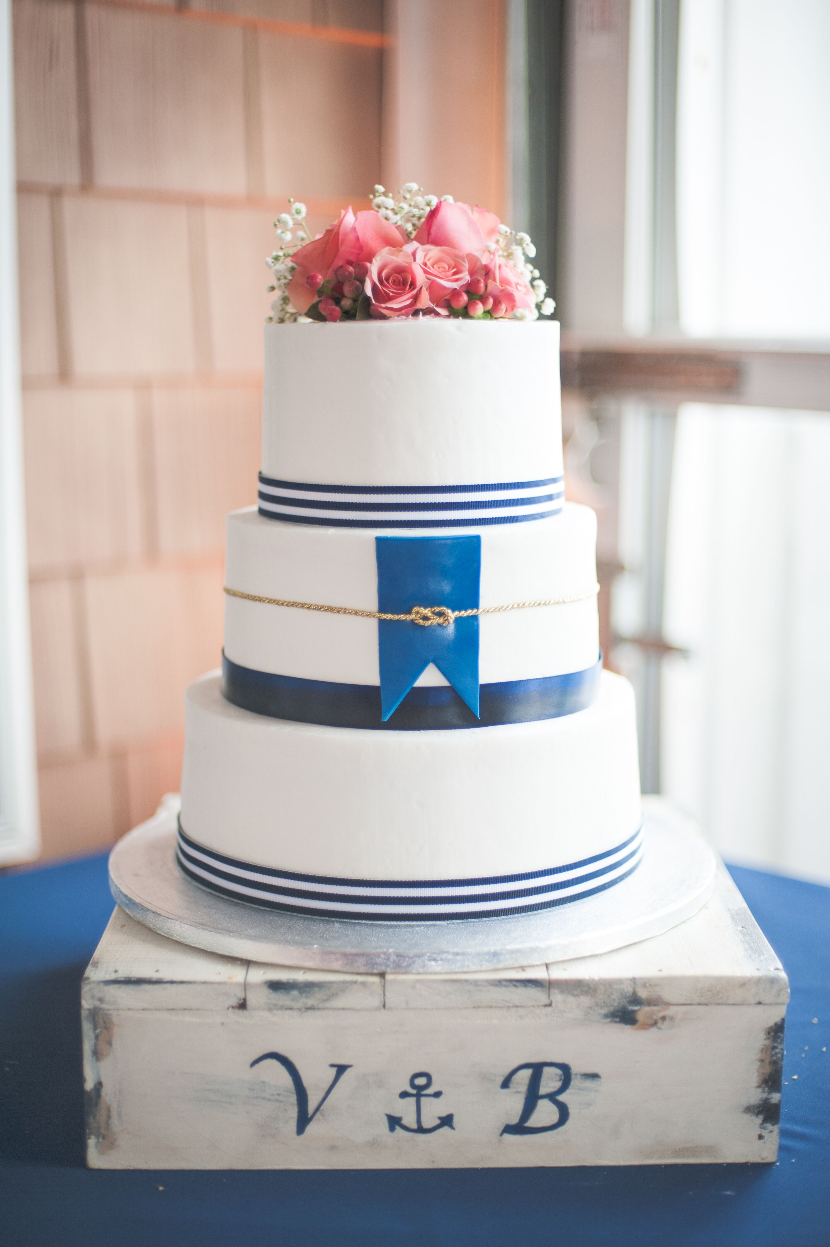 navy wedding cake stand nautical navy white and coral cake with monogrammed cake 17792