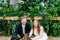 Dog lovers Katie Shade (30 and a mental health counselor) and Buck Dickinson (35 and a project manager) filled their greenhouse venue with navy accent