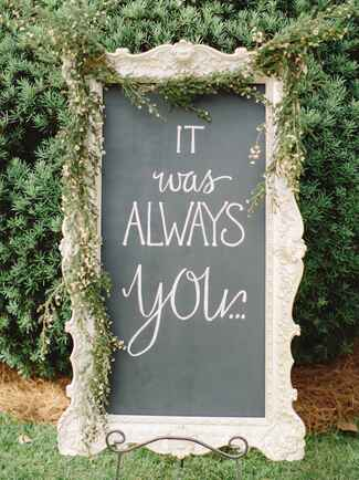 Elegant chalkboard sign displaying romantic quote