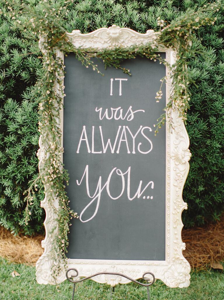 Elegant chalkboard sign displaying romantic quote