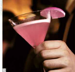 pink cocktail with a pink lime wedge