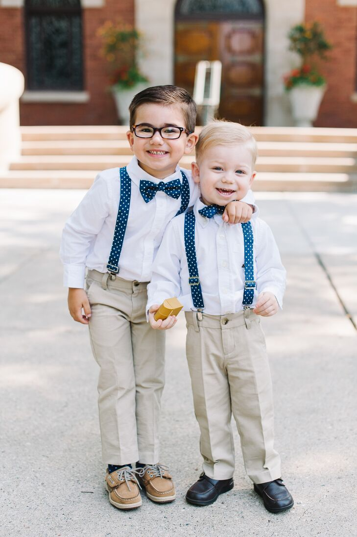 "Matt's two nephews wore navy and white polka dot bow ties to serve as the couple's ring bearers. ""They held hands walking down the aisle and carried a small pillow with faux rings,"" Anna says. ""We didn't want to risk losing the real ones!"""