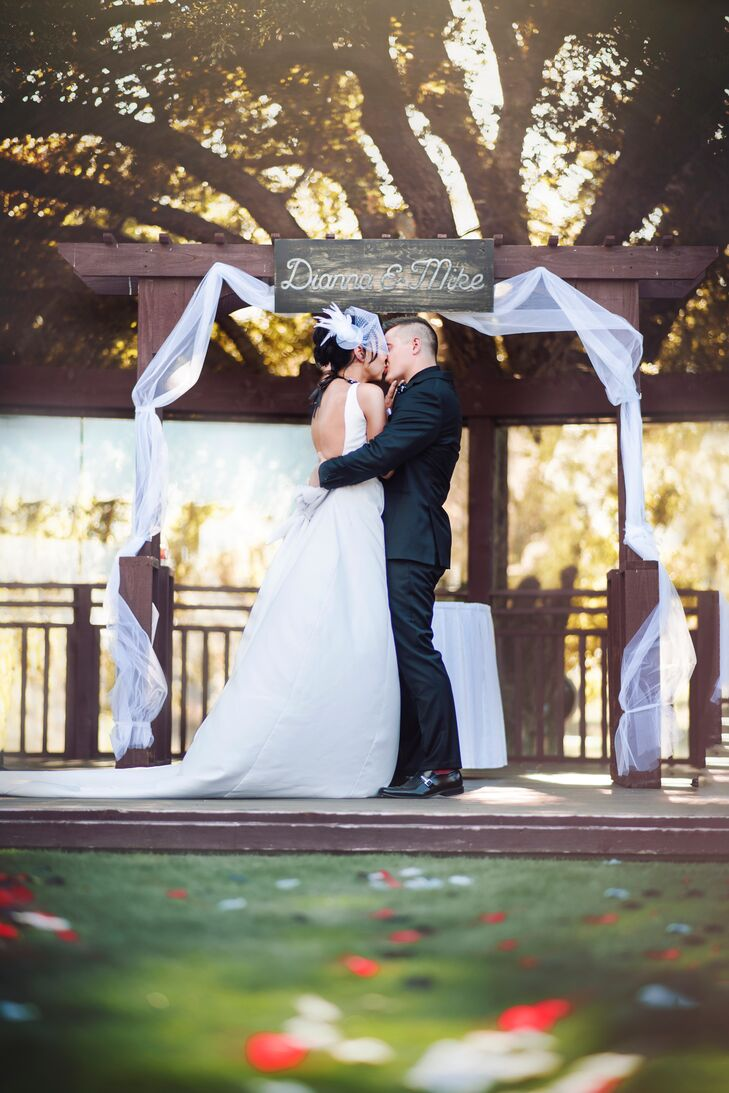"""The wedding was held at the Journey Golf Resort at Pechanga in Temecula, California,"" says Mike. ""The ceremony was outdoors with the main seating on grass, and Dianna and I were raised on a wood deck with a massive oak tree behind us. It was slightly rustic with a classic twist."""