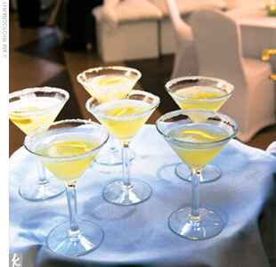 yellow cocktail in a martini glass