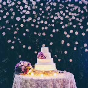 Purple wedding cakes tropical cake adorned with purple flowerstropical cake with adorned with purple flowers junglespirit Choice Image