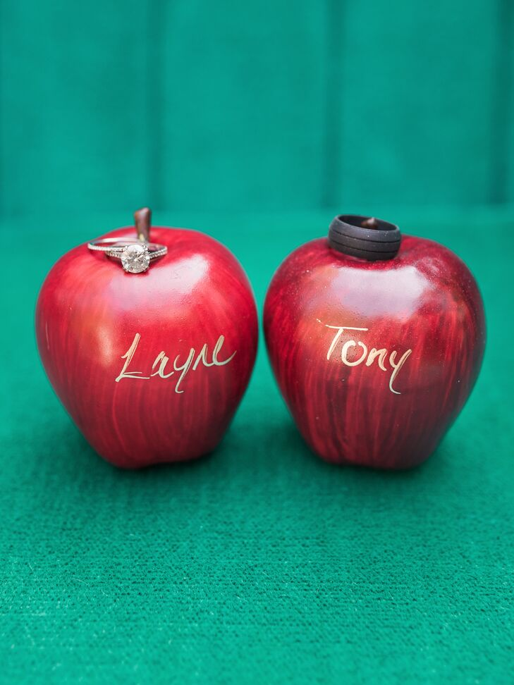 Each guest's name was calligraphed in gold ink onto a shiny red apple and placed at their seat for the reception.