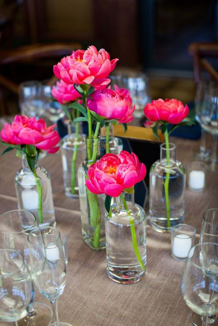 The centerpieces were small glass bottles filled with individual peony stems. My main request to the florist was to incorporate peonies, if possible, into my bouquet, Jennifer says. She warned that it might be too early in the season for peonies, so I was thrilled that she was able to get them after all!