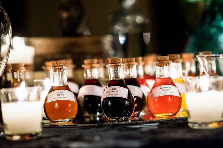 To find their tables, guests located their names printed on brightly colored liqueurs in potion bottles (which doubled as favors). In keeping with the science-meets-magic theme, each table was named for an element from the periodic table (such as copper, mercury and gold).
