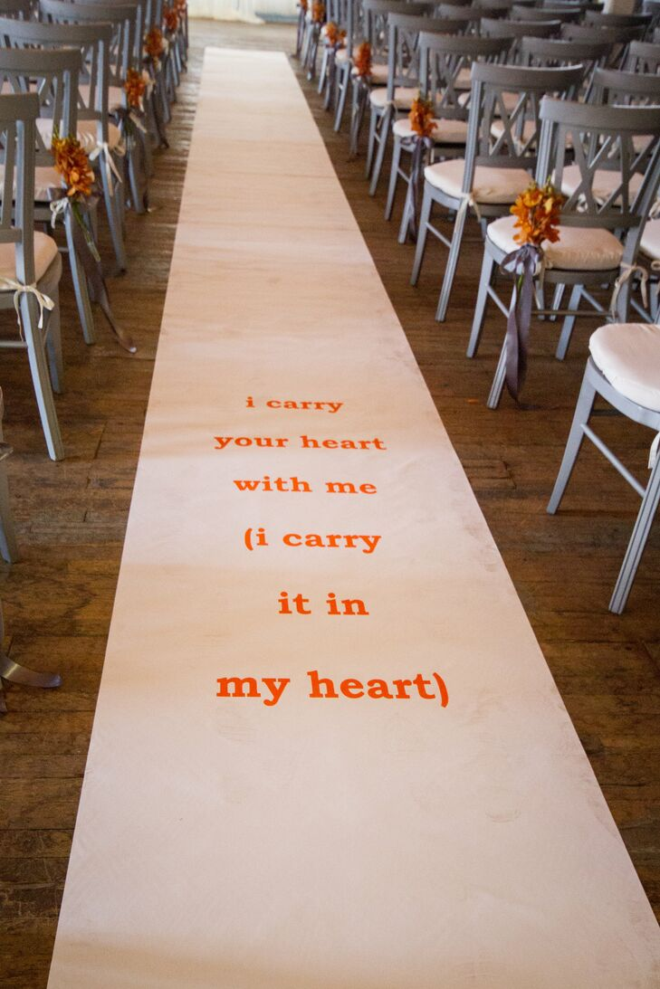"To punch up an otherwise simple aisle runner, the couple added a line from the famed ""I Carry Your Heart With Me"" poem by E.E. Cummings that read ""I carry your heart with me (I carry it in my heart)."""
