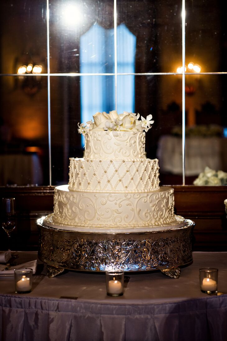 Intricate Three-Layer Cake With Flower Topper