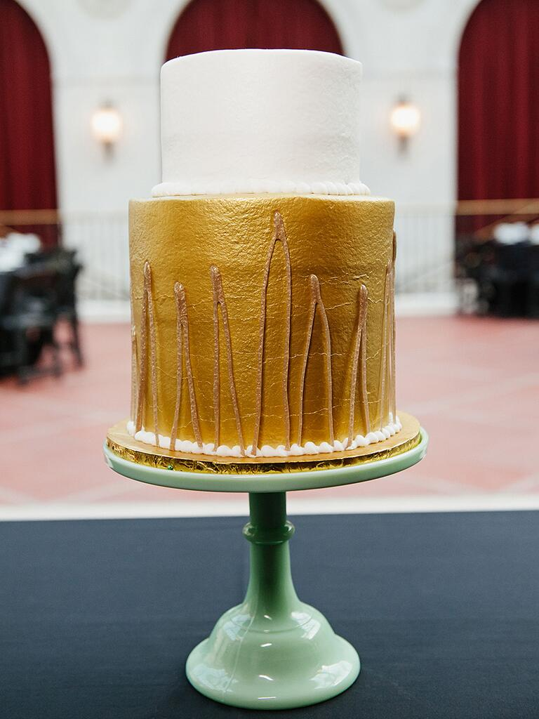 Two-tier wedding cake with gold metallic frosting