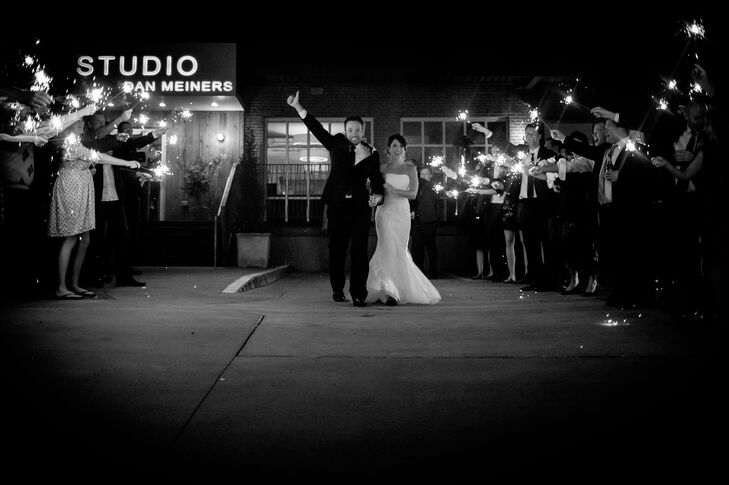 Sarah and Matt left their reception through their guests waving sparklers.