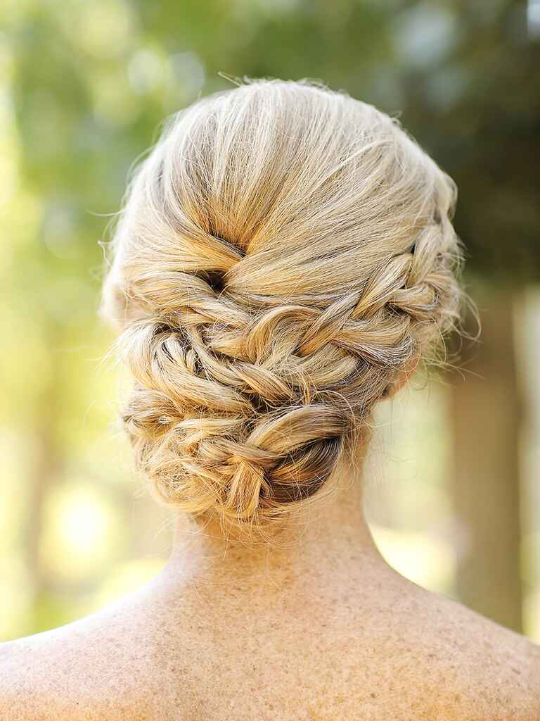 Romantic low braided chignon updo hairstyle idea for brides or bridesmaids