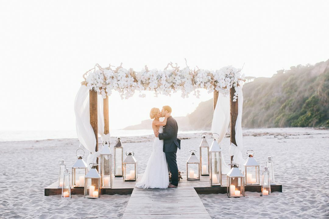 Outdoor Wedding Flower Ideas For A Beach Wedding: Romantic Wedding On The Sand With White Flower Arch