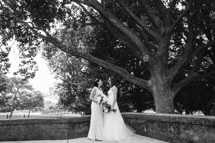 """I picked my dress from BHLDN because when I tried it on it was the most comfortable dress ever; Jamie instantly started to cry,"" Elana says. ""It was decided before I even looked in the mirror."" Her wedding dress had a classic vintage feel with a chic lace overlay, V-neck and slight pleating along the end of her skirt. A silver beaded belt was also wrapped around her waist."