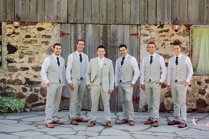 The groomsmen all found affordable suits from a variety of vendors: gray vests and pants from Express, white shirts from Macy's, brown wingtip shoes from Kohls, and matching belts and ties from Target.