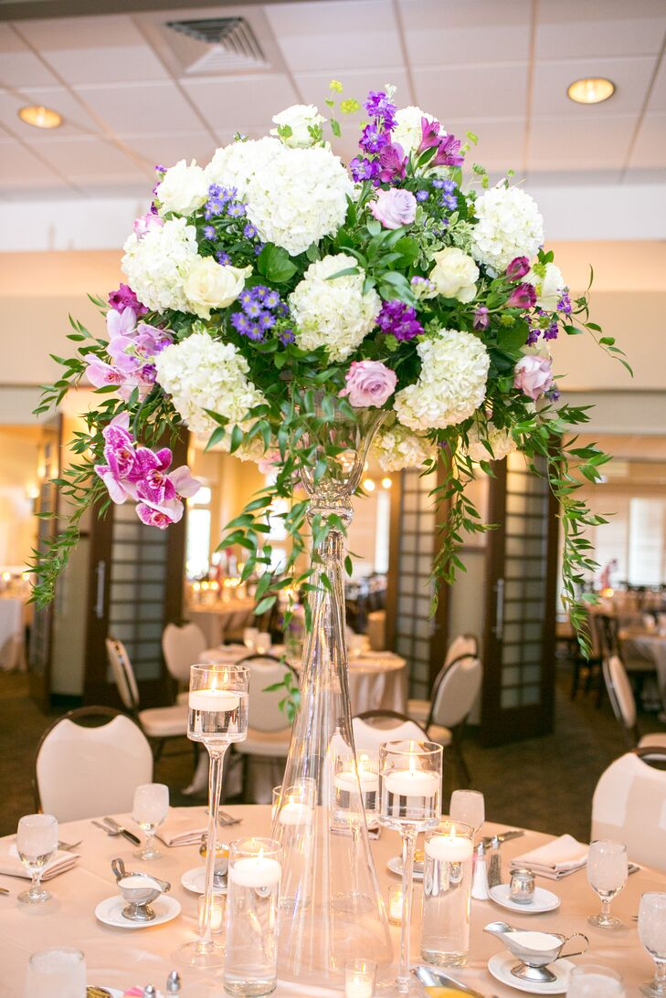 Purple rose and white hydrangea centerpiece in tall glass