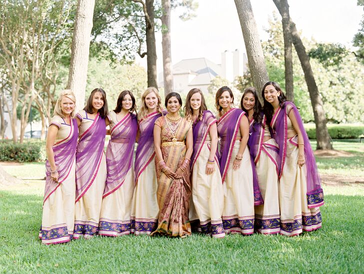 The bridesmaid Indian ceremony outfits were custom-made from India and highlighted the purple, fuchsia and gold palette of the morning celebration. They came in two styles: one with a crop top and one with a longer tunic, so each woman could choose the option she felt most comfortable wearing.