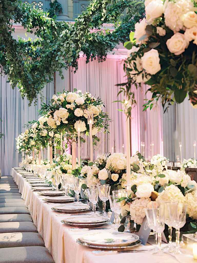 Glamorous wedding reception tablescape with tall and short centerpieces
