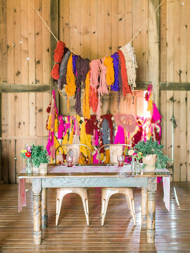 DIY yarn backdrop for wedding reception decor