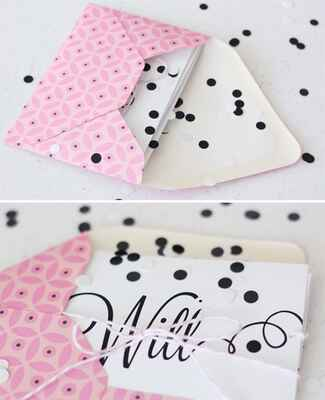 pink envelope filled with black and white confetti