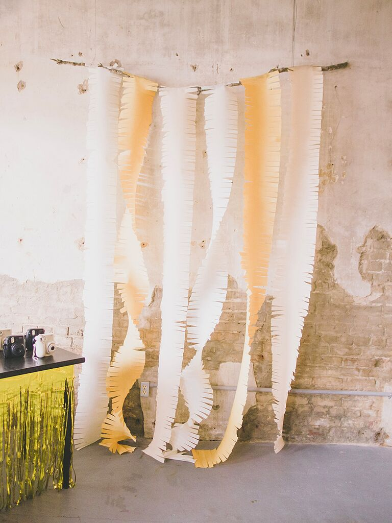 DIY crepe streamer wedding reception backdrop