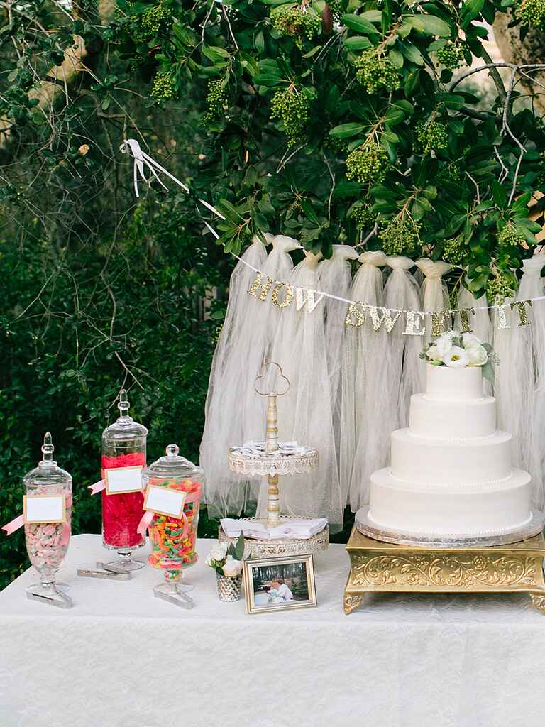 Wedding reception cake table with a candy bar
