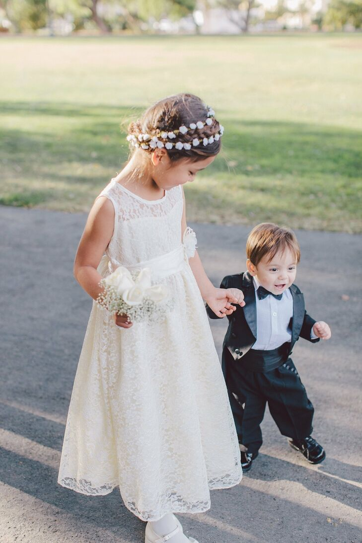 The flower girl wore a sleeveless lace dress and accessorized with flowers in her hair while the ring bearer sported a mini tuxedo.