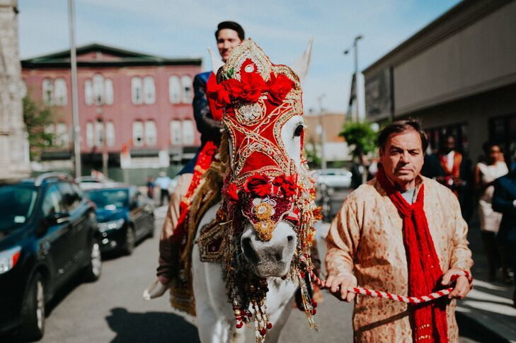"Christophe arrived to the ceremony on horseback in traditional fashion, surrounded by his friends and family, who danced alongside him as he made his way toward Vie in Philadelphia, Pennsylvania. ""It's called a baraat, and it is the traditional way for the groom to make his entrance and formally greet the bride's family,"" Anjali says."