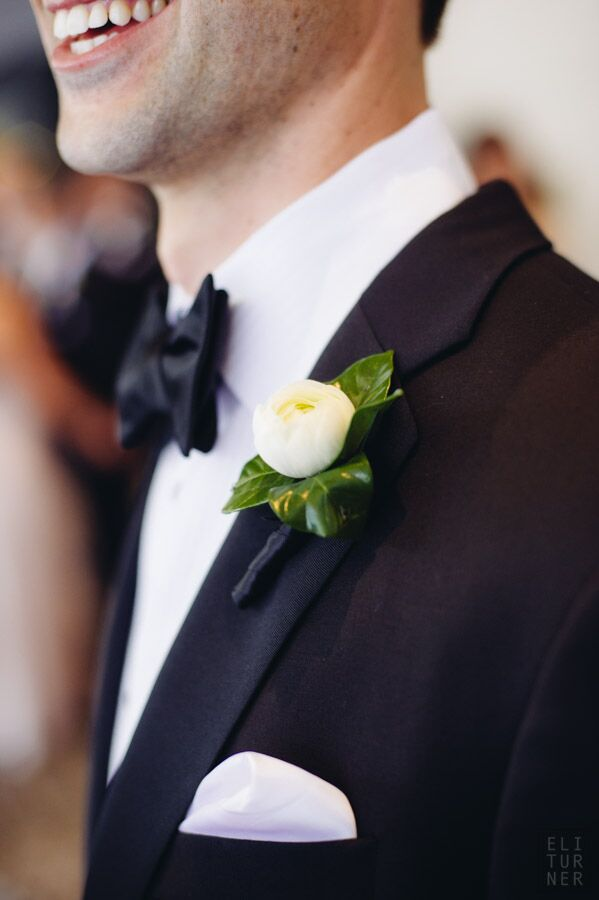 Alex wore a white ranunculus boutonniere with his Vera Wang tuxedo and black bow tie.
