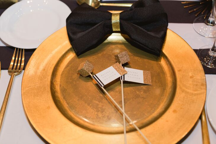 """As an alternative to place cards, I made cocktail swizzle sticks with a gold geometric cube on the end,"" says Shawn. ""I added a little flag that contained the name of each guest, and had the swizzle sticks waiting for the guests in their champagne glasses for the toasts."""