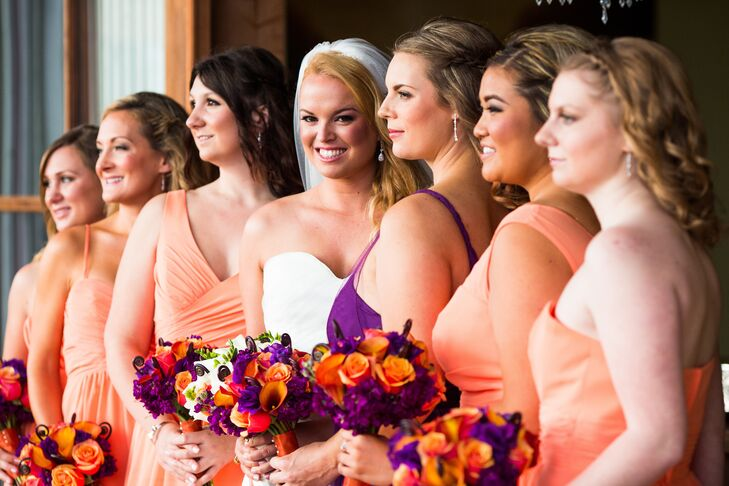 The bridesmaids wore short tangelo dresses and held bouquets filled with orange roses and calla lilies accented with purple stock.