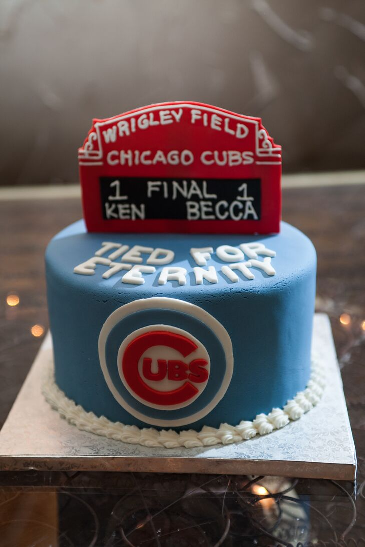 "The groom's cake was a Chicago Cubs-inspired single-tier cake with a scoreboard that gave Rebecca and Ken one run each. The cake read, ""Tied for Eternity."""
