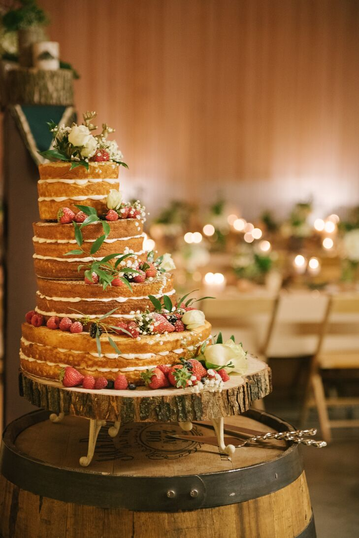 "The newlyweds cut into a homemade, lemon-flavored naked cake using a traditional Japanese sword purchased during their time abroad. ""My aunt made the cake for us,"" Taylor says. ""It helps having a large extended family!"""