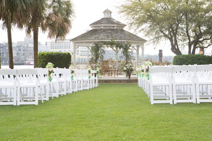 The stunning garden ceremony took place on Westin's river front lawn, which overlooked the city of Savannah.