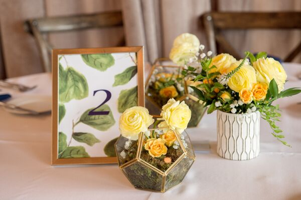 Table Number with Fig Leaf Illustration Alongside Geometric Centerpieces