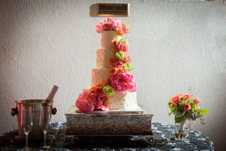 Even the wedding cake was given a colorful flourish, with vibrant pink peonies and color roses cascading down the sides.