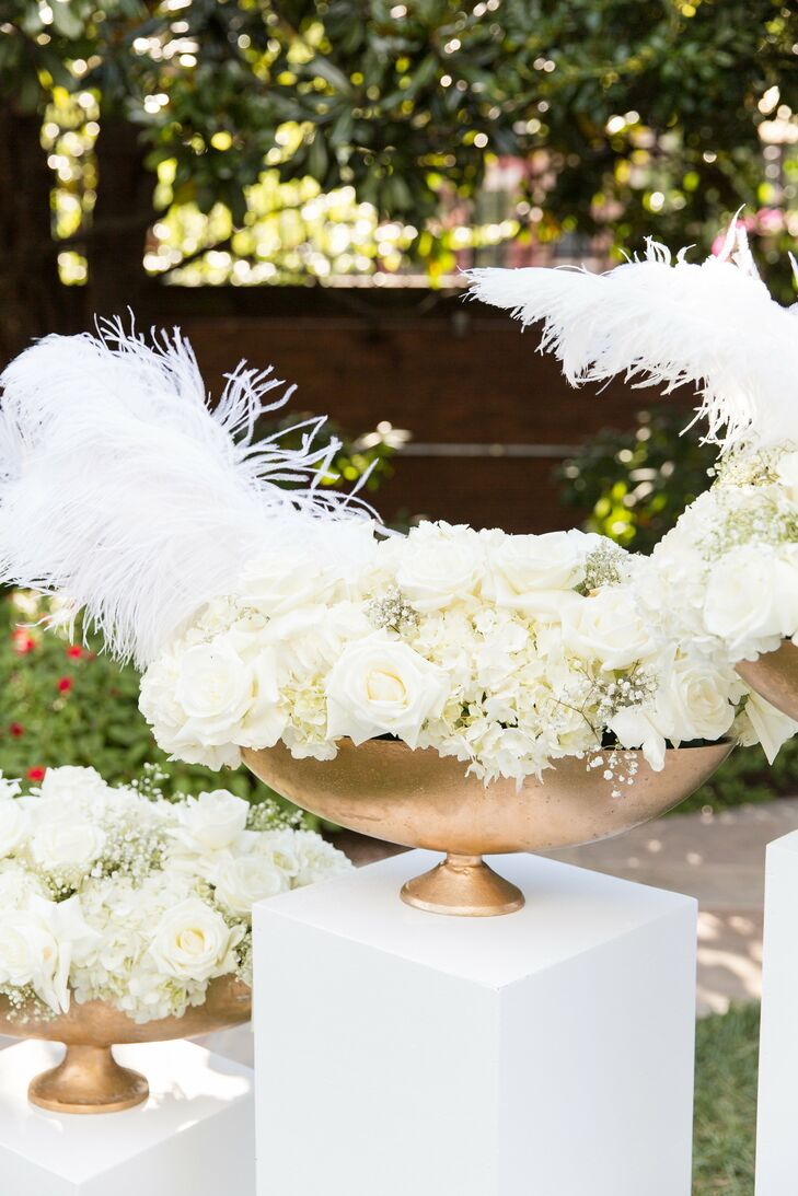 Glamorous All White Flower Arrangement With Feathers