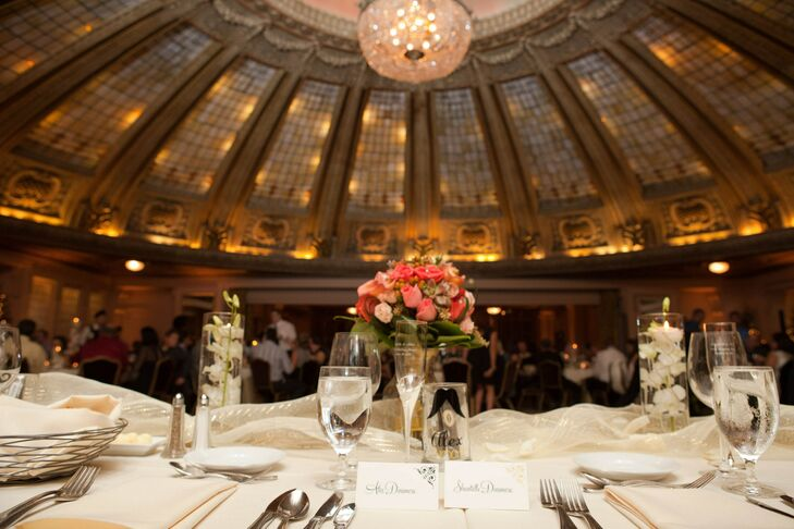 Ivory dining tables had matching napkins and were decorated with a coral flower centerpiece.