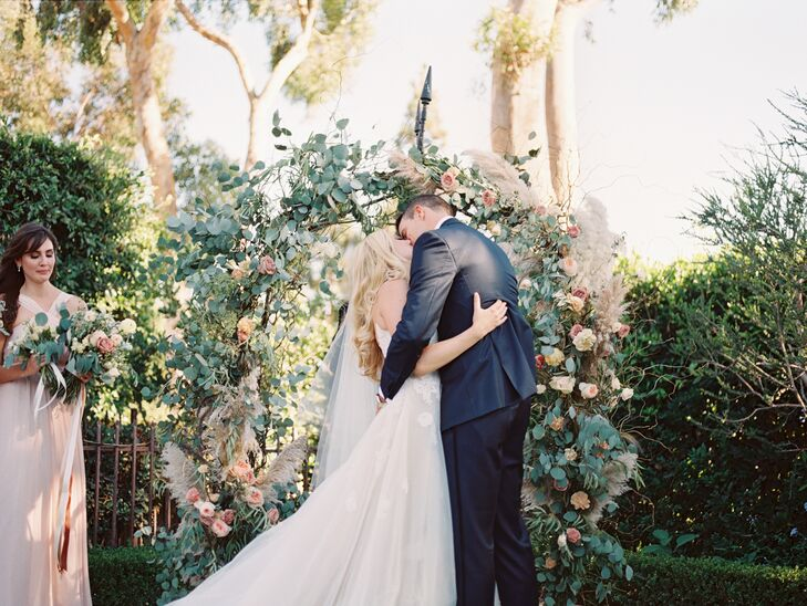 After a brief 15-minute ceremony under a handcrafted floral arch at Villa Sancti Di Bella Vista in Malibu, California, Cassidy and Cutter had their first kiss.
