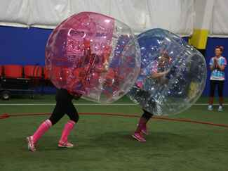Bridal Wars contestants play bubble soccer