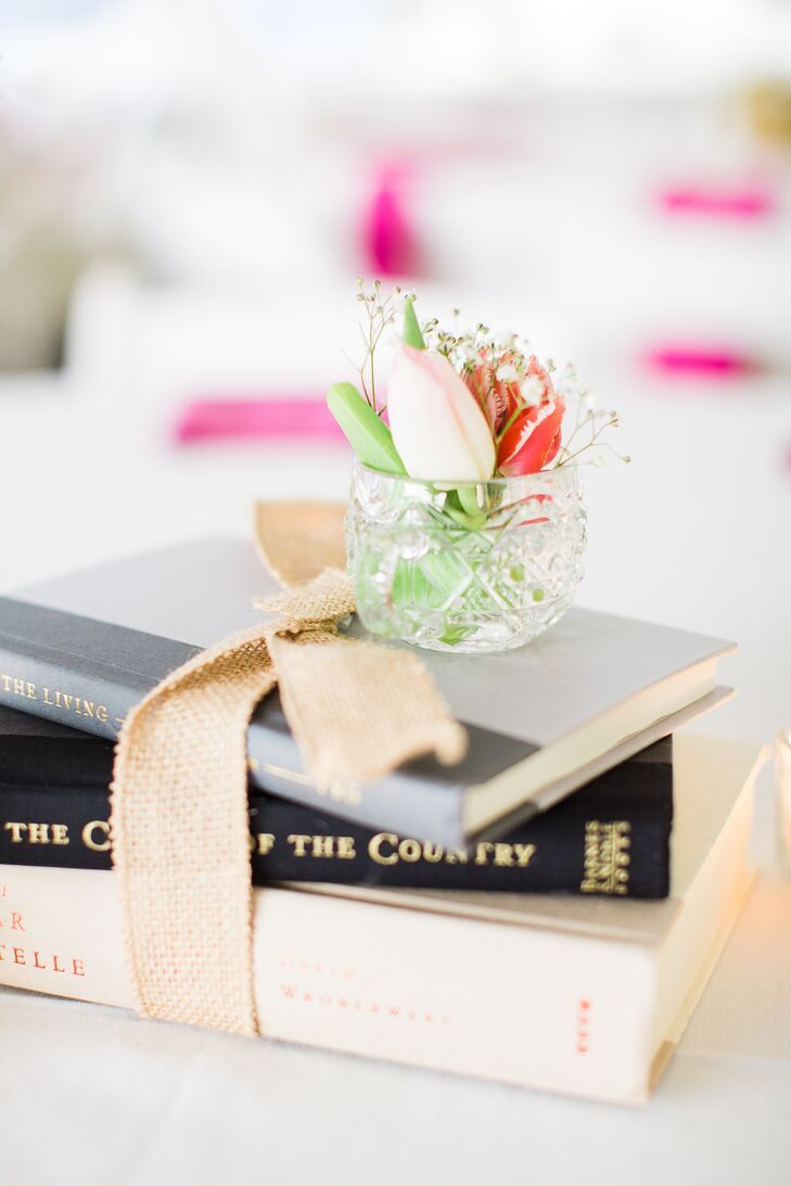 Since Sophia and Jake love to read, her mother went thrift shopping for books to use in the centerpieces. She tied each stack together with a burlap bow for a little rustic flair.