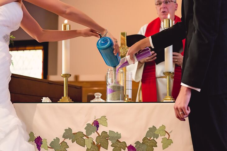 The couple performed a sand-pouring ceremony during their ceremony, with Laura pouring blue sand and Piotr pouring purple sand.