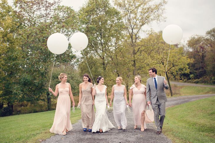 "Once Erin gave her bridesmaids and bridesman a gold, neutral, blush, pale blue and mint color palette, they were free to pick any outfit of their choosing. Each woman chose a long, light-colored gown with a sweetheart neckline. Erin's brother had something a little extra special in mind. ""My brother wore the same suit he wore to his own wedding just four months earlier,"" she says."