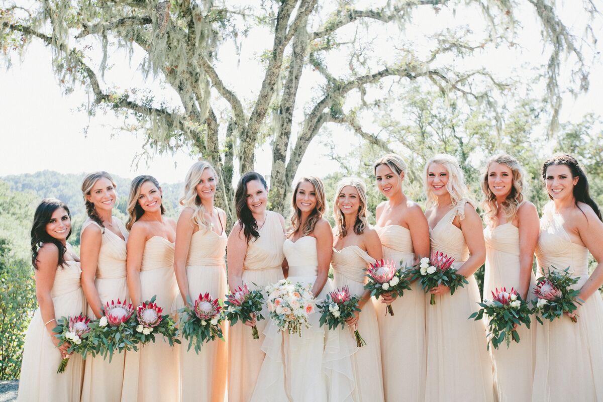 Protea and eucalyptus bouquets long cream colored amsale bridesmaid dresses ombrellifo Gallery