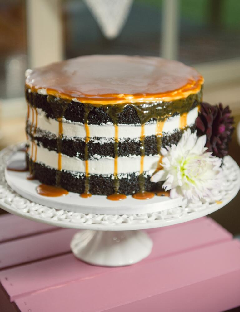 Black and white naked cake with caramel drip garnish